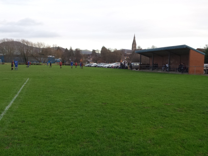 The main stand at Ruthin with the town's church in the background