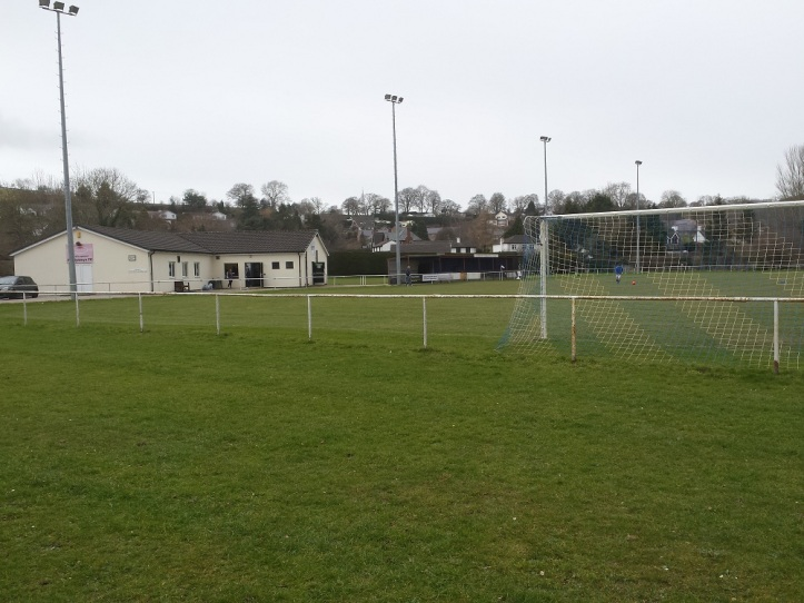 View of the clubhouse and stand from the car park.