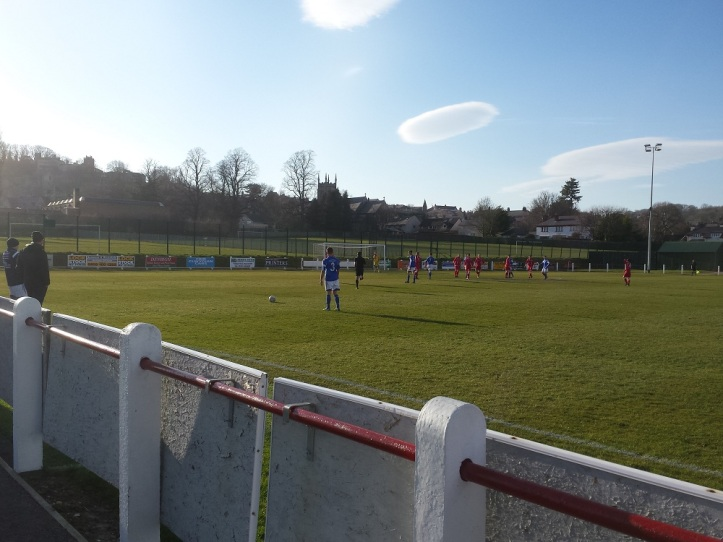 Caersws free kick with the visiting management team watching