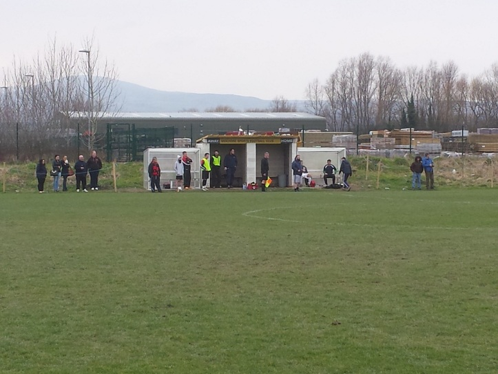 The dugouts with the Gaerwen supporters to the left of them