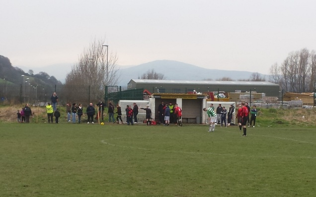 The referee sends the Gaerwen supporters out of the dugout area!