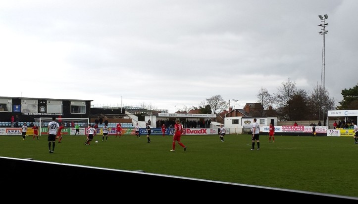 Rhyl on a rare attack early in the 2nd half. Note the supporters huddled under the cover of the snack bar!