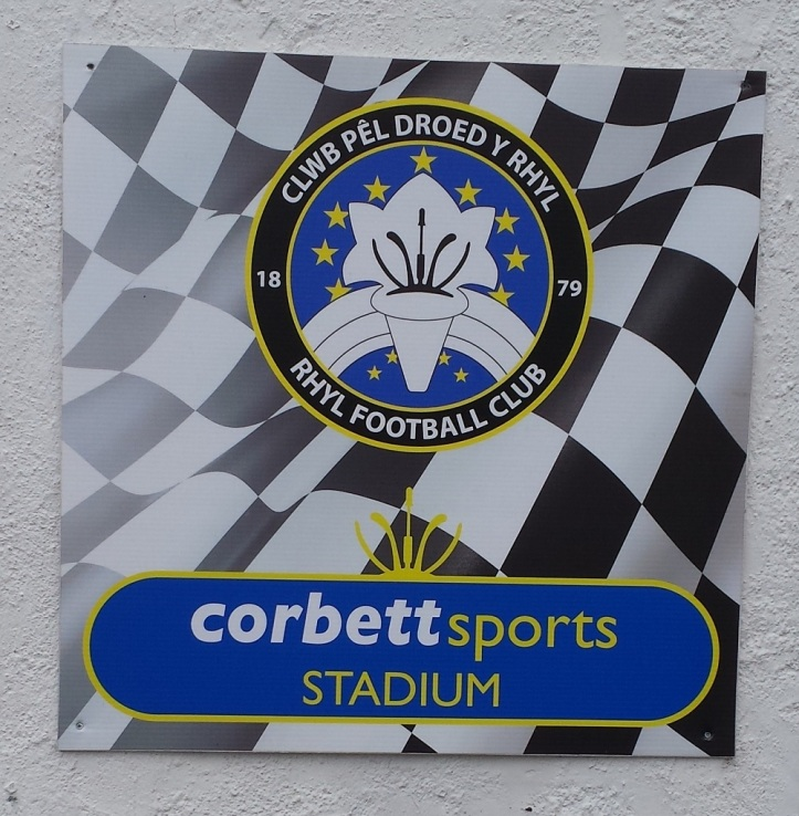 Rhyl's badge with the sponsored name for the ground!