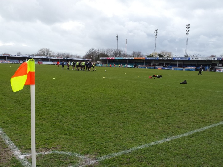 The teams doing some pre-match warm ups with the main stand in the background