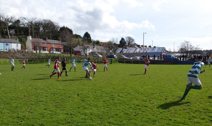 Glan Conwy on the ball trying to get into the match