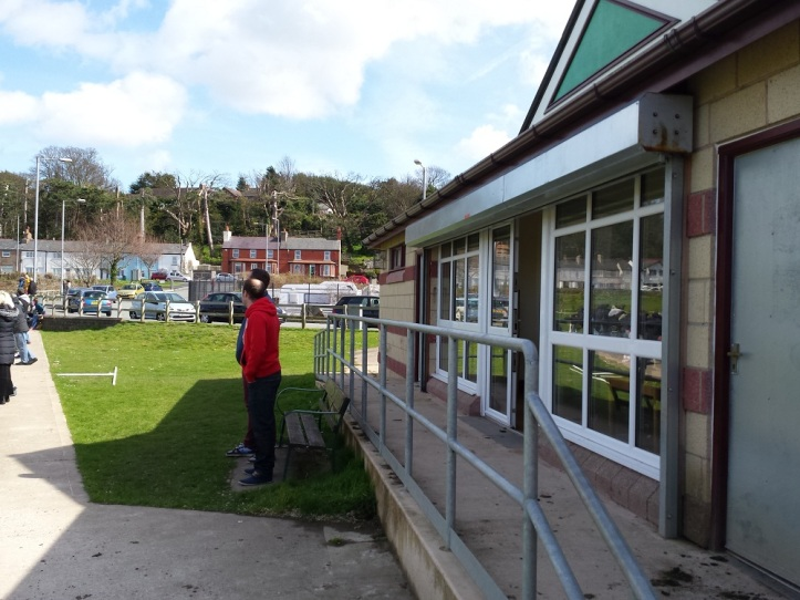 The clubhouse at Cae Ffwt with Greg & Stu watching the action on the pitch