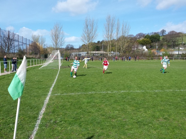 Attempted clearance from the Glan Conwy defender