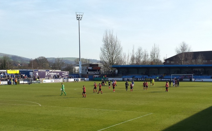 Wrexham applauding their supporters in the Silkmen Terrace