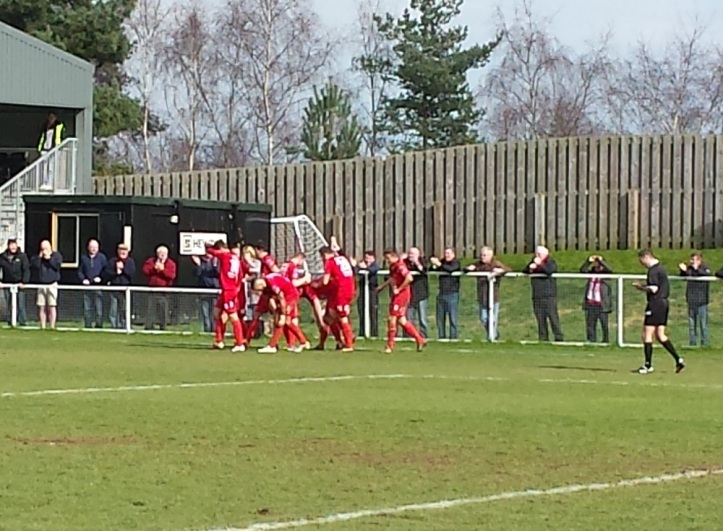 Newtown celebrating their 2nd goal and one step nearer to the elusive final