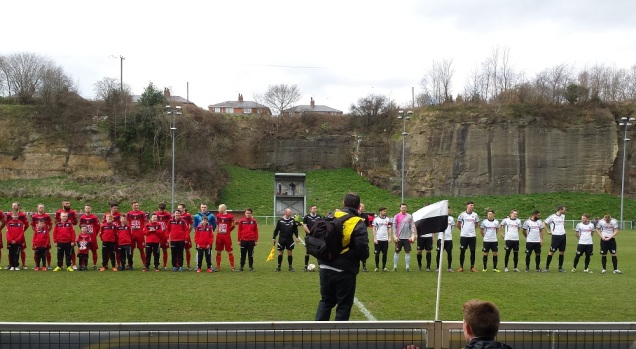 The teams line up prior to the match