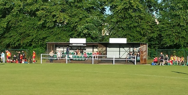 The main stand with the dugouts either side of it.