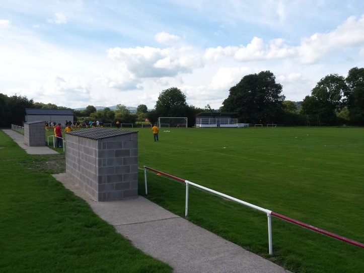 The permanent dugouts with the main stand in the background