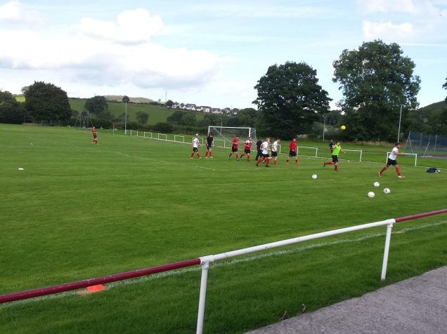 Corwen with their pre-match training
