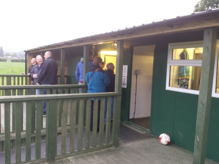 The wooden clubhouse (with Greg queuing up for refreshments)