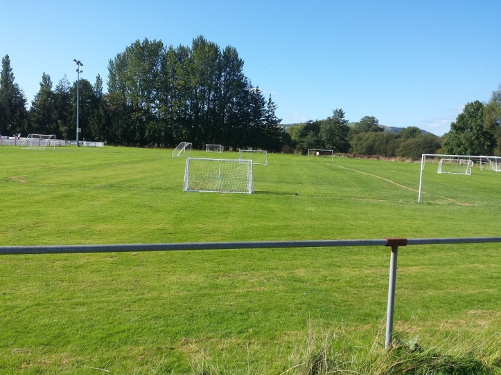 Playing fields between the small stand and entrance