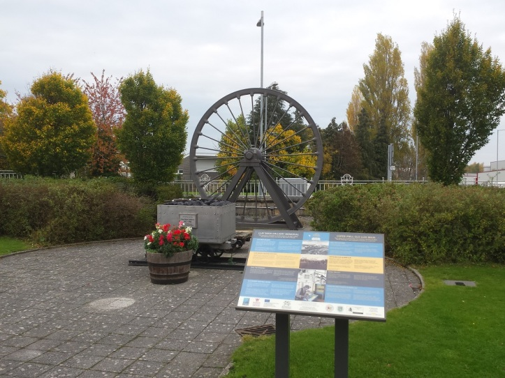 The Llay Main Colliery Memorial in front of the Miners Welfare building