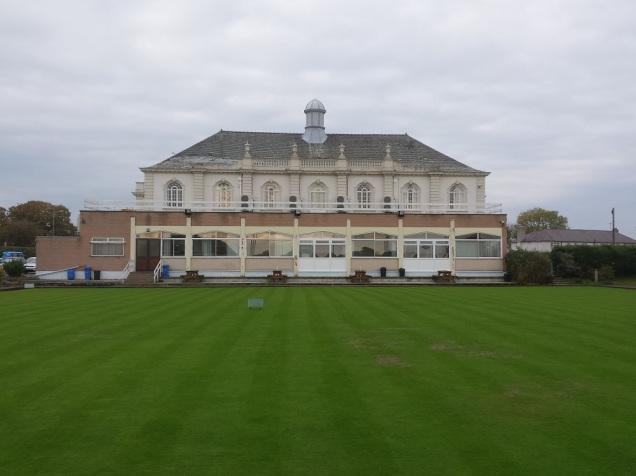 The back of the building with the immaculately kept grounds